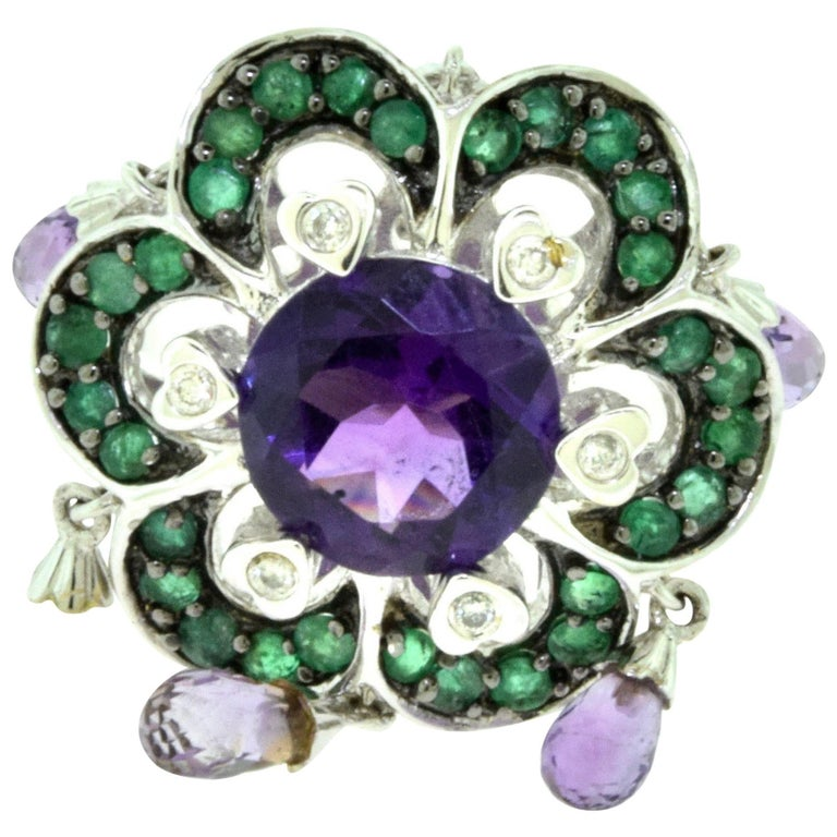 amethyst emerald and jingle dangle ring in 18