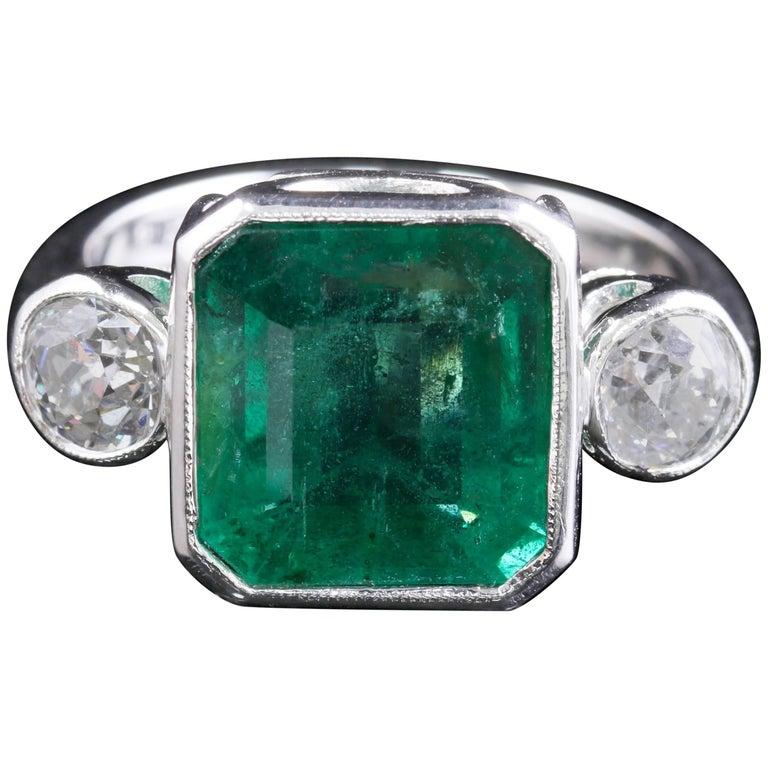 Art Deco Emerald Diamond Platinum Ring 8 Carat Emerald 1.20 Carat Diamond
