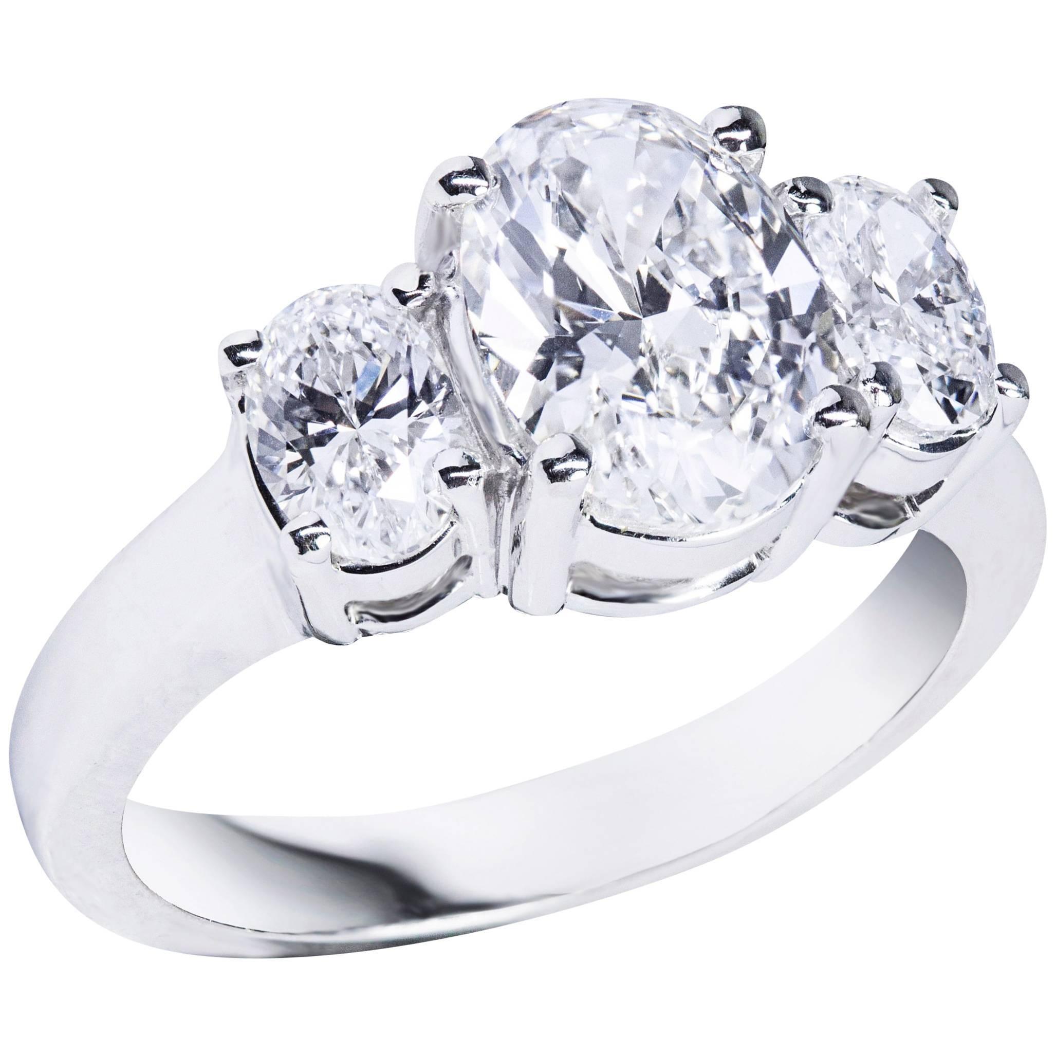 GIA Certified Oval Cut Diamond Platinum Three-Stone Engagement Ring
