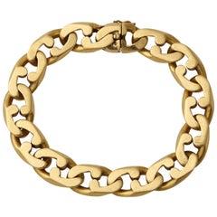 1980s Tiffany & Co. Interlocking Jagged Curb Link Gold Unisex Flexible Bracelet