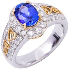 Oval Shape Tanzanite and Diamond Two-Tone Gold Ring