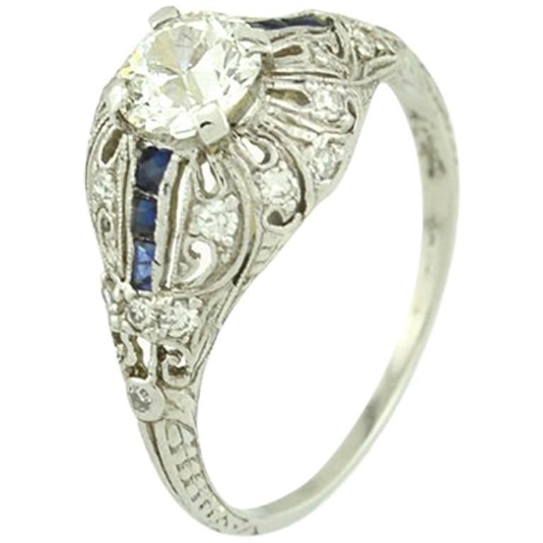 Art Deco 0.66 Carat Old Cut Diamond and Sapphire Platinum Engagement Ring