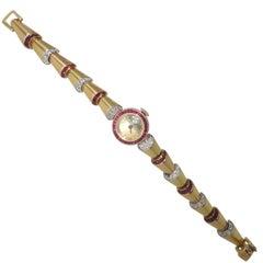 Oscar Heyman Yellow Gold Diamond Ruby Retro Bracelet Wristwatch, circa 1950