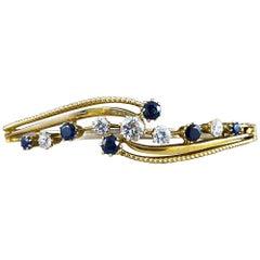 Antique Edwardian Diamond and Sapphire Bangle Bracelet in 15 Carat Gold