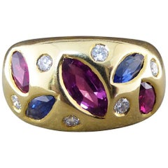 Contemporary Ruby, Sapphire and Diamond Gypsy Ring in 18 Carat Gold