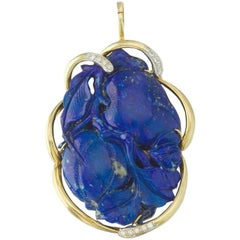 1970s Striking Large Carved Lapis Pendant in Gold with Diamonds