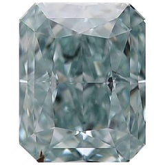 Exceedingly Rare GIA Certified 0.90 Carat Fancy Intense Blue Green Diamond