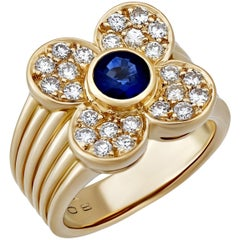 Van Cleef & Arpels Diamond and Sapphire Gold Flower Ring