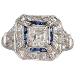 GIA Certified 1.01 Carat Diamond and Sapphire Platinum Engagement Ring