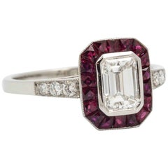 Art Deco 0.72 Carat Emerald Cut Diamond Ruby Halo Platinum Engagement Ring