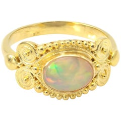 Ethiopian Oval Opal Gold Ring with Granulation and Spirals in Yellow Gold