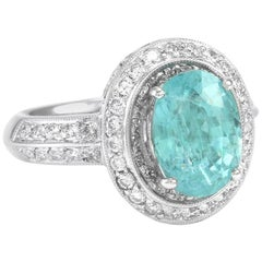 3.30 Carat Paraiba Tourmaline and Diamond Halo Ring in Gold