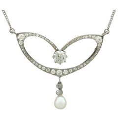 1910s Pearl and 2.61 Carat Diamond Yellow Gold Necklace / Brooch