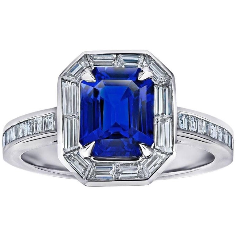2.55 Carat Emerald Cut Blue Sapphire Baguette Diamond Halo Ring For Sale