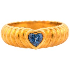 Tiffany & Co .50 Carat Blue Sapphire and 18K Gold Ring