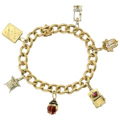 Cartier 18 Karat Gold French Retro Loaded Charm Bracelet, circa 1950s