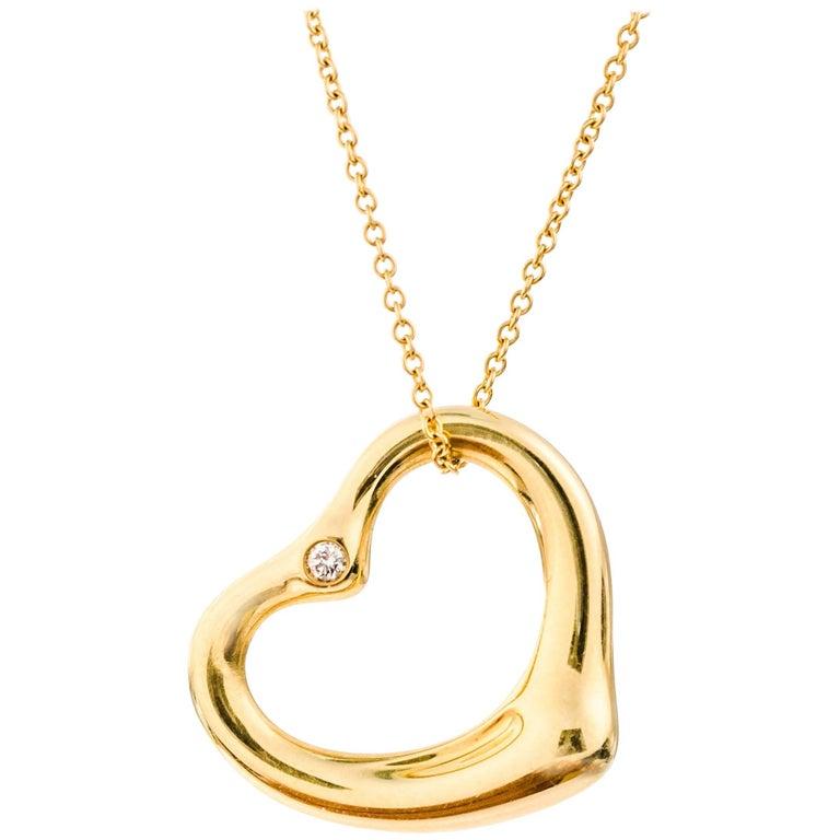 77b5a019d27a9 Tiffany & Co. Elsa Peretti Open Heart Diamond and 18K Gold Necklace
