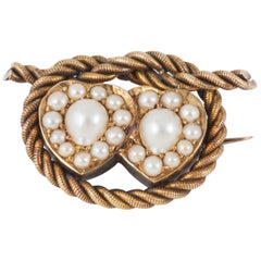 Hearts entwined ,19th Century Natural Pearl and Gold Brooch, circa 1880-1890