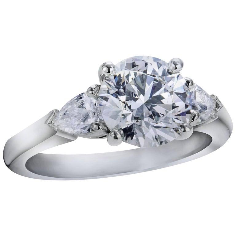 Round Brilliant Diamond Platinum Three-Stone Engagement Ring