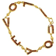 "Meaningful Lucien Piccard Gold and Garnet ""I LOVE YOU"" Bracelet"