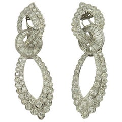 Tailored Looking White Gold Hanging Earrings Set with Diamonds