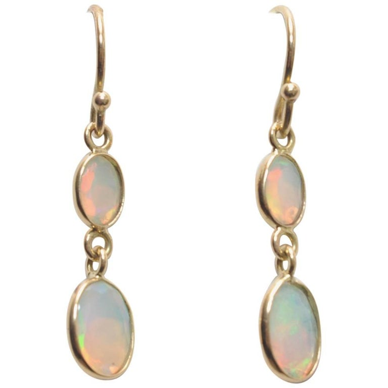 Double drop Faceted Opals and 18K Gold Earrings For Sale