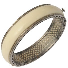 White Bakelite Bangle Bordered with Diamonds