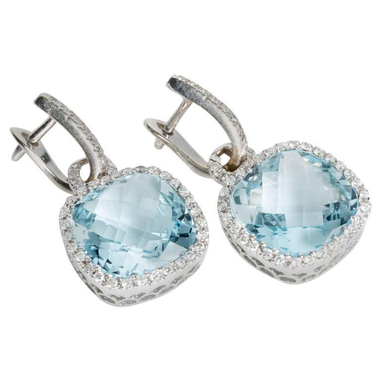 Blue Topaz and Diamond 18 Karat White Gold Halo Style Drop Earrings