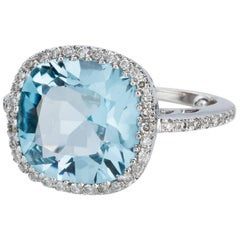 Blue Topaz and Diamond 18 carat White Gold Halo Style Dress Ring