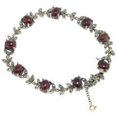 Garnets Diamonds and Rose Gold Link Bracelet