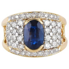 Oval Blue Sapphire and Round Diamond Ring