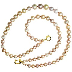 Double Strand Necklace of Lustrus Peachy Pearls with Orange Sapphire Accents