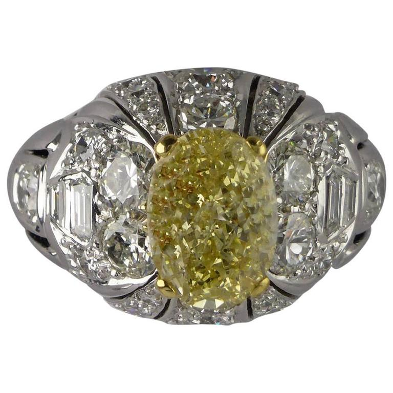 Certified Fancy Yellow Diamond 2.11 Carat Gold Bombe Ring, circa 1960