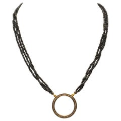 Diamond Circle Pendant and Black Spinel Beaded Necklace