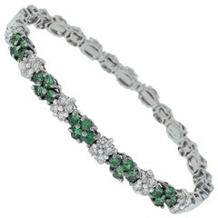 18 Karat White Gold Flower Design Diamond and Tsavorite Bracelet