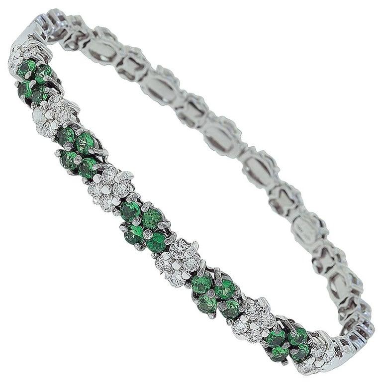 18 Karat White Gold Flower Design Diamond and Tsavorite Bracelet