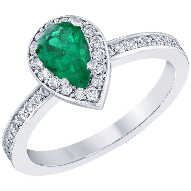 0.76 Carat Emerald Diamond Engagement Ring For Sale