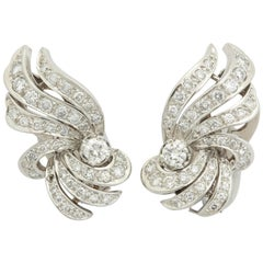 1950s Flame and Wing Design Diamond Encrusted Platinum Earclips with Posts