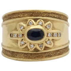 1980s Wide Hand-Hammered and High Polish Sapphire and Diamond Unisex Gold Ring