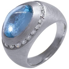 Dome Ring with Blue Topaz Cabochon and Diamonds
