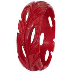 Art Deco Cherry Red Bakelite Bangle, Deep Leaf Carvings and Cut-Outs from Bangle