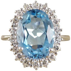 Blue Topaz and Diamond Cluster Ring in 18 Carat White Gold