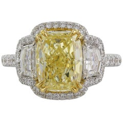 3.05 Carat GIA Certified Fancy Yellow SI2 Three-Stone Diamond Halo Ring