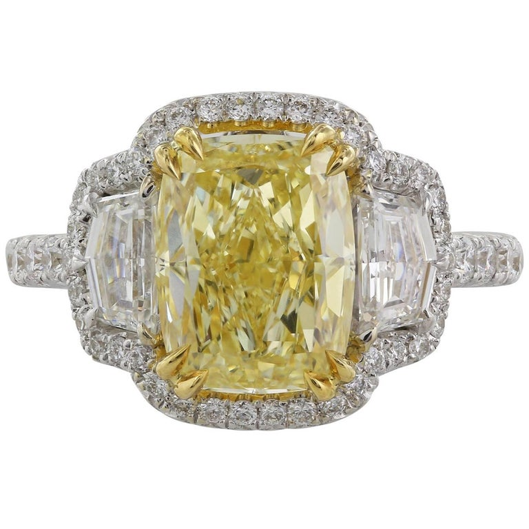 3.05 Carat GIA Certified Fancy Yellow SI2 Three-Stone Diamond Halo Ring