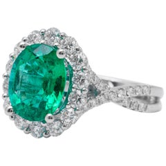 Emerald Diamond Halo Ring 18 Karat White Gold
