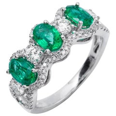 Oval Emerald and Diamond Accented Three-Stone Gold Band Ring