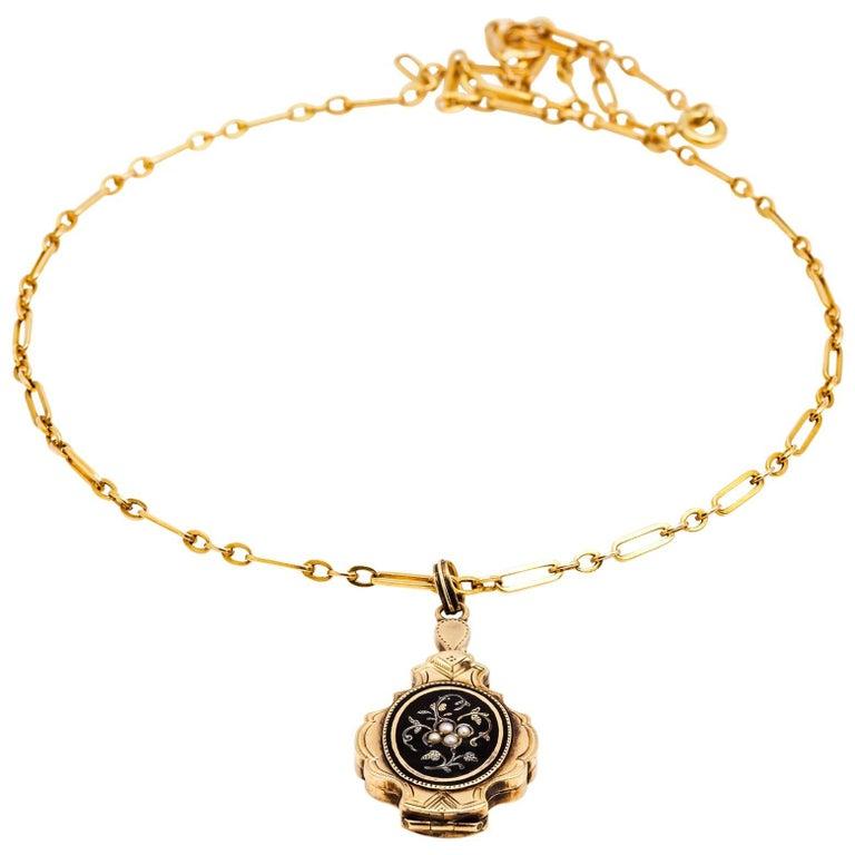 Antique Black Enamel, Pearl and Gold Locket in a Floral Design