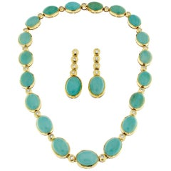 Turquoise Set in 18 Karat Yellow Gold and White Diamonds