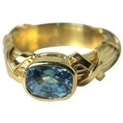 Glittering Blue Zircon 18KT Yellow Gold Ring