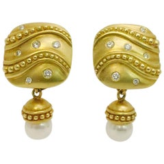 Elegant 18 Karat Diamond and Dangling Pearl Enhancer Earrings